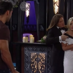 Maxie is held hostage at gunpoint while Nathan watches helplessly