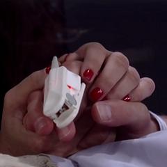 Sam holds Jason's hand (2014)