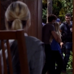 Nathan mouths to Maxie that he's coming