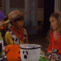 Aiden dressed as Buzz Lightyear for Halloween with Emma and Cameron