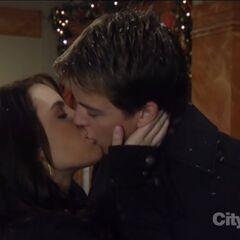 Michael and Kiki kiss on Christmas