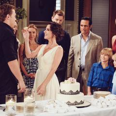 Sam feeds Jason wedding cake