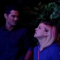 Nathan watches Maxie watch the fireworks