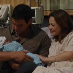 Nikolas holds baby Aiden