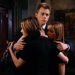 Michael, Kristina, Josslyn and Molly hug at Morgan's funeral