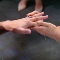 Sam puts the ring on Jason's finger