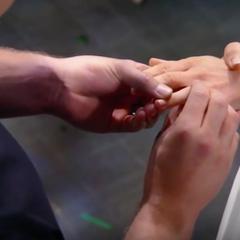 Jason puts the ring on Sam's finger
