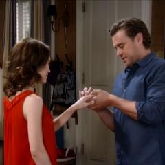 Jake puts the ring on Liz's finger