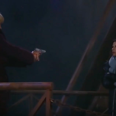 Olivia holds a pregnant Sam at gunpoint before she pushes her off a bridge
