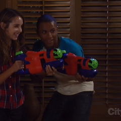 Molly and TJ with water guns (2012)