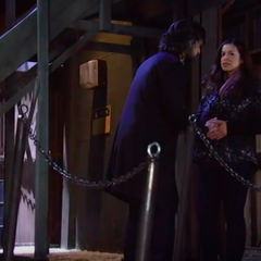Carlos puts his hand on Sabrina's belly