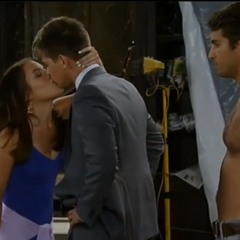 Michael and Kiki kiss at the Brownstone