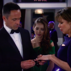 Julian puts the ring on Alexis' finger