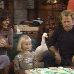 Serena with mom, dad and Sigmund the duck