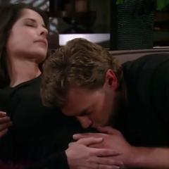 Jason kisses Sam's belly