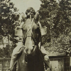 Elsie Martin riding on her sister's farm in Luzerne, Michigan in 1925.