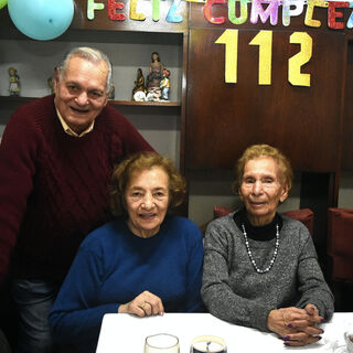 Evangelista Luisa Lopez on her 112th birthday with her Mario (aged 86) and her daughter Sara (aged 89).