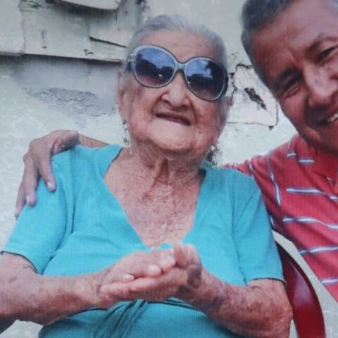 Rosa Ines Veloz Ortiz with her grandson Milton on her claimed 109th birthday.