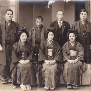 Kane (front row, centre) with her brothers and sisters.
