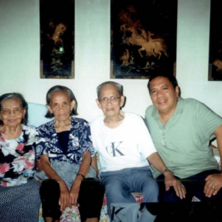 Flaviano Jubane (second from right) with his sister Severa Jubane (born 1924) (second from left).