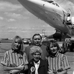 Hughes (front, centre) at the age of 109, just before boarding a flight on Concorde