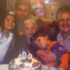 Virginia Constante on her 100th birthday with relatives.