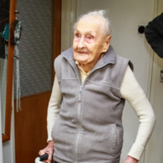 Veronika Zsilinszki standing at age 111.