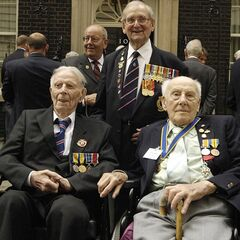 Three British veterans of World War I: Harry Patch (left), William Stine (centre) of the Royal Navy and Henry Allingham (right) at a reception for British military veterans in 2006.