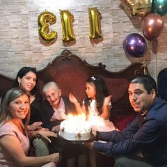 Virginia Constante on her 113th birthday, with her relatives.