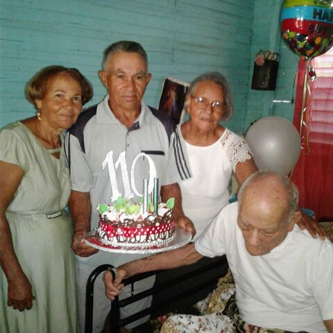 Neuton Fermin with his three children on his 110th birthday.