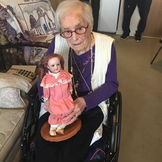 Ellison at the age of 109, with a doll she had since the age of two