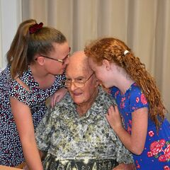 Kruger celebrating his 109th birthday with his two great-granddaughters