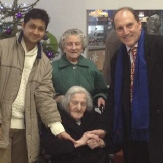 Jones, 113 (seated), celebrating Christmas in 2012, with MP Simon Hughes (right)