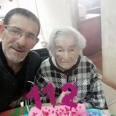 Benegas on her 112th birthday with her grandson Tomas Antonio Blanco.