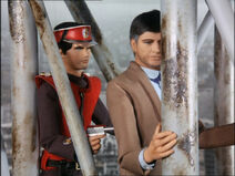 Captain Scarlet holding the President at gunpoint