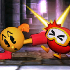 <b>PAC-MAN</b> kicking the   out of a Dig-Dug enemy.