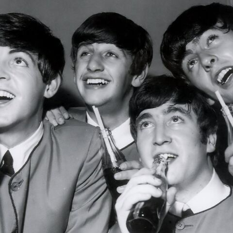 The Beatles enjoying some refreshing Coca-Cola.