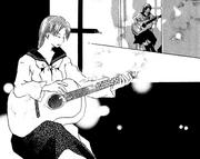 Noguchi playing the guitar