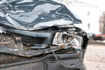 6034884-a-wrecked-car-lays-in-wait-after-a-vicious-car-accident