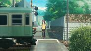 Mafuyu waiting for the train to stop