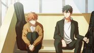 Mafuyu and Ritsuka sitting on the steps together