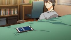 Ritsuka looking at the text on his bed