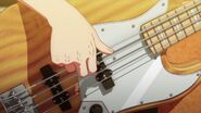 Haruki strumming his bass