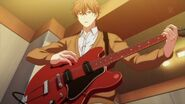 Mafuyu looking down at his guitar