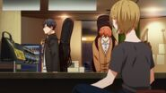 Mafuyu greeting the lady at the front desk