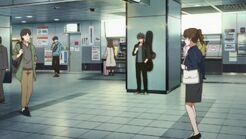 Ritsuka looking at his phone at the station