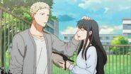 Akihiko fixing Yayoi's hair