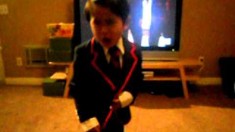 Mini warbler performing to teenage dream