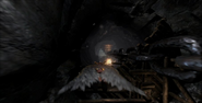 Kratos desplazandose con la alas en God of War III