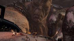 Kratos en el brazo de Cronos